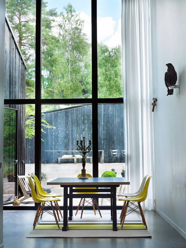 Yellow Eames chairs in a Swedish lake house - via My Scandinavian Home