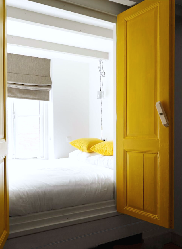 Yellow doors for the bedstead - via French By Design